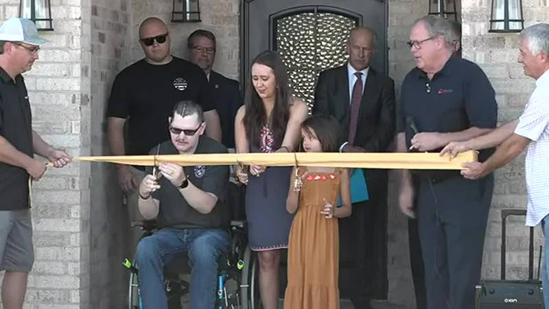 Dawson family cutting the ribbon for their new home