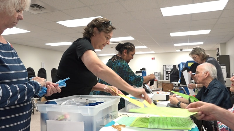 Poll workers undergo training before every election