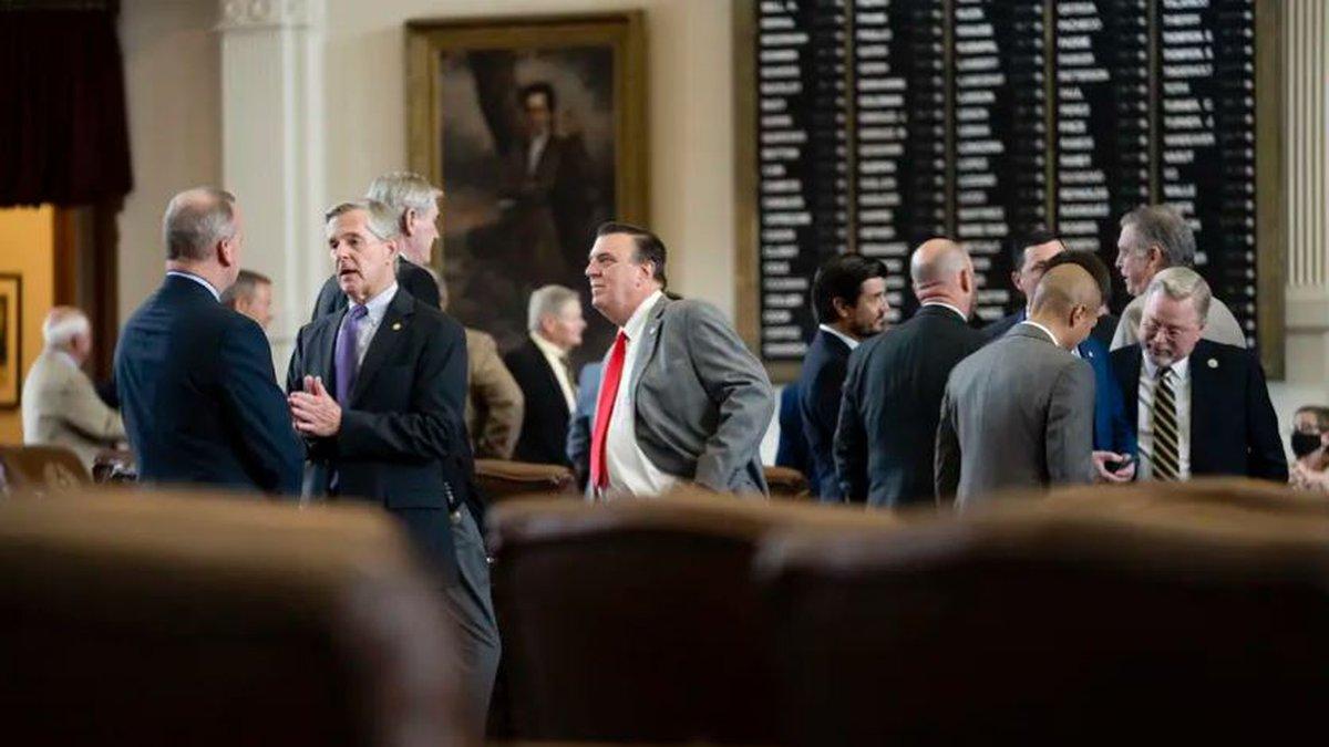 Legislators talk on the House floor on July 29, 2021