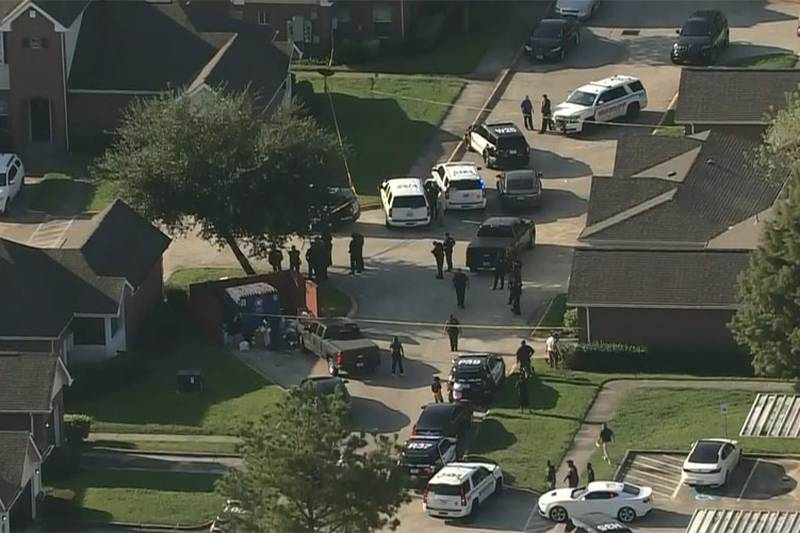 Officers are at the scene of a shooting in Houston on Monday. An officer died and another was...