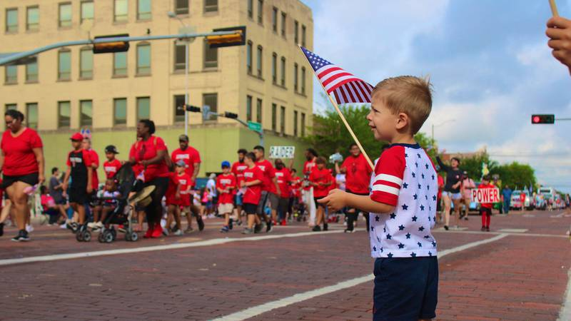 Child enjoys Fourth on Broadway parade