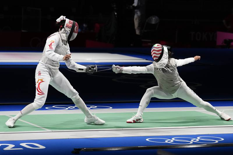Lee Kiefer of the United States, right, and Berthier Amita of Singapore compete in the women's...