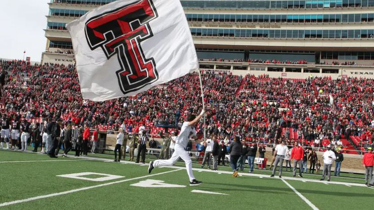 A Texas Tech cheerleader enters the field before a game against Texas Christian University at...